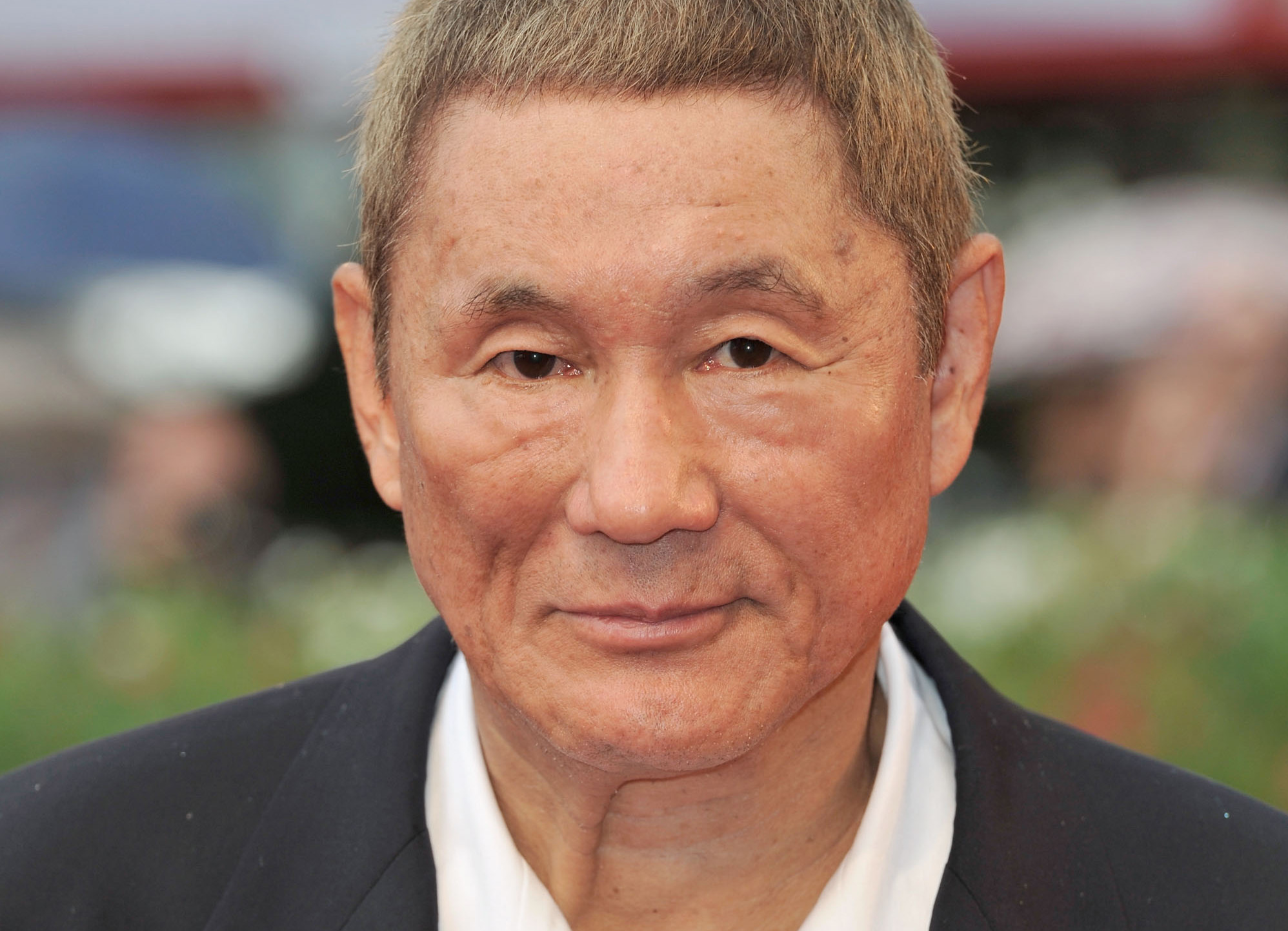 "VENICE, ITALY - SEPTEMBER 03: Director Takeshi Kitano attends the ""Outrage Beyond"" Premiere during the 69th Venice Film Festival at the Palazzo del Cinema on September 3, 2012 in Venice, Italy. (Photo by Gareth Cattermole/Getty Images)"