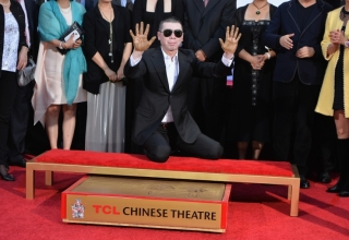 HOLLYWOOD, CA - NOVEMBER 01:  Director Feng Xiaogang attends a ceremony immortalizing him with a hand and footprint at TCL Chinese Theatre IMAX on November 1, 2013 in Hollywood, California.  (Photo by Alberto E. Rodriguez/Getty Images)