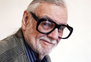 LUCCA, ITALY - APRIL 07: American film Director, screen writer and editor George Romero poses for a photo after attending a press conference during the Lucca Film Festival 2016 on April 7, 2016 in Lucca, Italy.  (Photo by Laura Lezza/Getty Images)